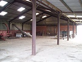 Photo of the inside of a barn building on a working farm