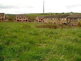 Photo of local residential area with Emley Moor TV mast in background